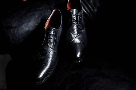 Stylish mens shoes on a table on a dark wooden background. mens shoes on a dark background