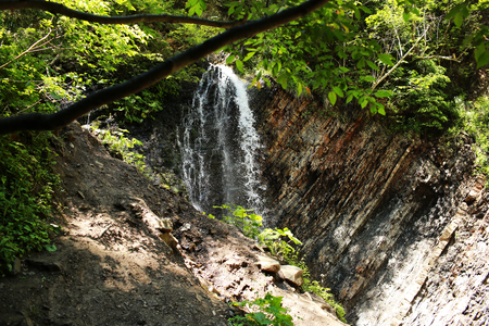 mountain waterfall. waterfall in national park. In the deep forest on mountain.