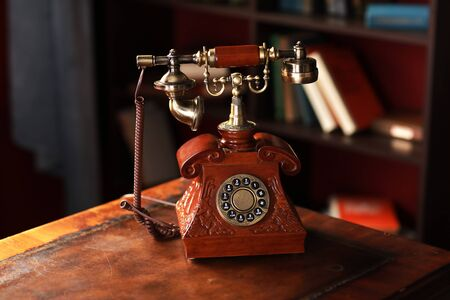 Old vintage retro telephone station. Great interior object. Old fashioned telephone. Vintage red phone