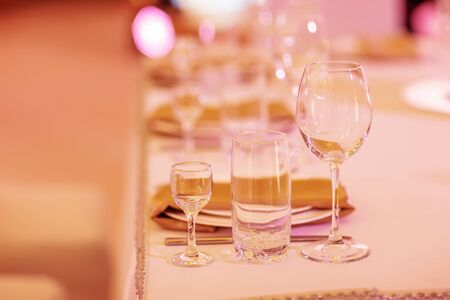 Serving on the table. Crystal glasses. Wedding. Banquet.