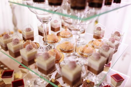 Wedding candy bar with a lot of different desserts. Selective focus.