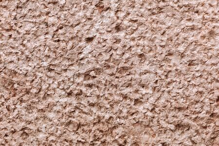 The texture of rough brown cement.