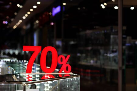 Season sale, black friday and shopping concept. Discounts in the shopping mall. Sale sign with Red label 70 percent discount. concept of seasonal winter sale, Mega sale Stok Fotoğraf