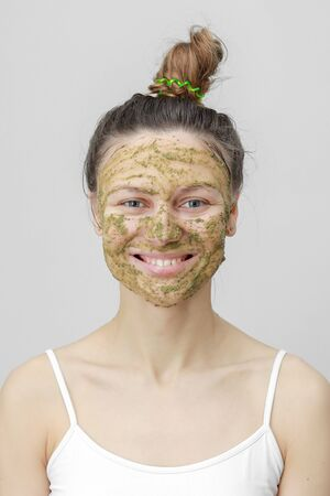 Beautiful woman with natural face mask clean skin rejuvenation isolated on white background.