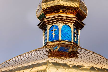 The golden and blue domes with crosses of the orthodox church. selective focus