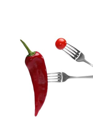 Close up of fresh red pepper and cherry tomato on forks isolated on white background. Proper nutrition, vegetarian food, healthy lifestyle, vegetable concept Stockfoto - 146713766