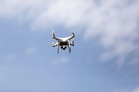 Quadcopter drone in sky. Small drone flies in sky taking video and photos. Remote control air delivery and spy. selective focus