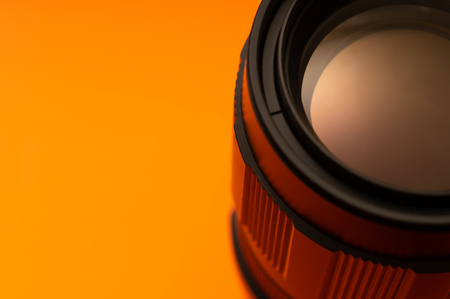 Part of photo lens orange background with glow on surface