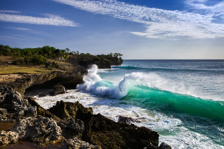 Beautiful wave near Bali island rocky coast, Indonesia Stock Photo