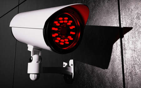 paranoia: Security camera on wall. Dark background. 3D rendering. Stock Photo