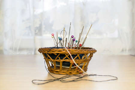 a basket with a cushion for needles, a seamstress-tailor. Needles, pins
