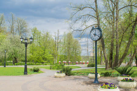 Clock in a green city park of culture and recreation