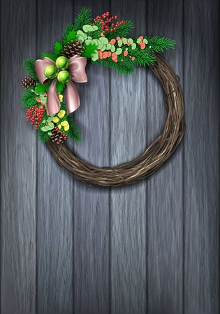 circular shape: Christmas Wreath. Evergreen holiday wreath with bow and red berries in circular shape on wood background.