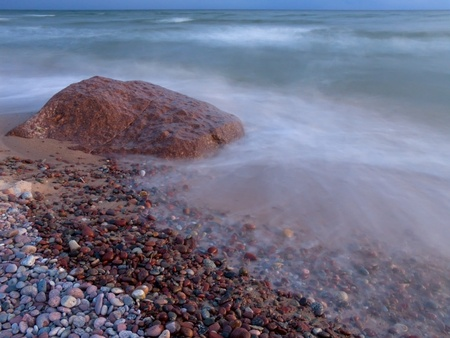 The sea wave rolls on a stony beach. Stock Photo - 10331197