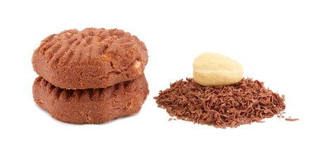 Chocolate cookies with the rubbed chocolate and the Indian nut on a white background. photo