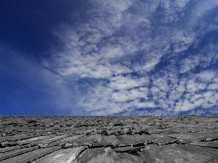 Fragment of old wooden roof against the sky. photo