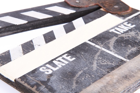 clapper board on isolated white photo