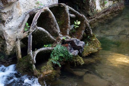waterwheel: Old broken water mill wheel. Krka national park. Croatia.