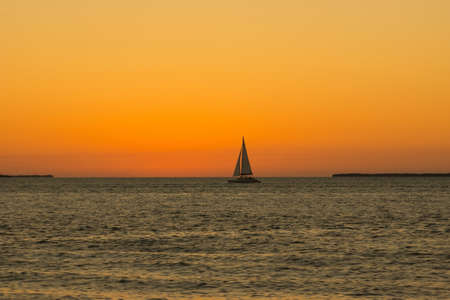 key west: Small jacht on sunset near Key West Florida US Stock Photo