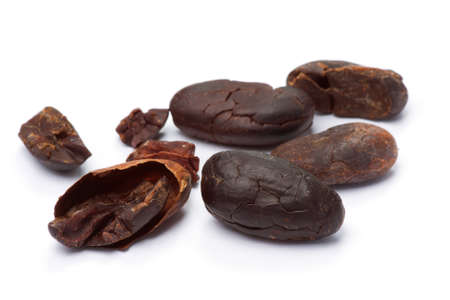 Cacao beans isolated on white background. Shallow depth of field.