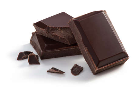 dark chocolate: Three  pieces of Chocolate isolated on white, cleaned and retouched photo. Stock Photo