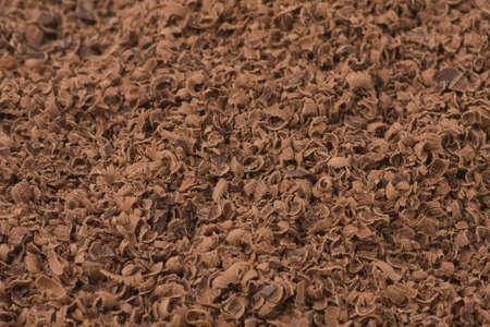 Grated dark chocolate background  Closeup  Shallow depth of field  photo