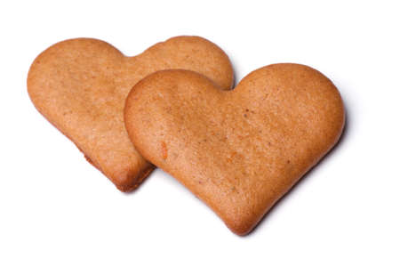 heart-shaped gingerbread cookies close-up on a white background photo