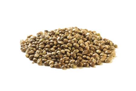 Pile of hemp seeds isolated on white background. Vegetarian Food. Stock Photo