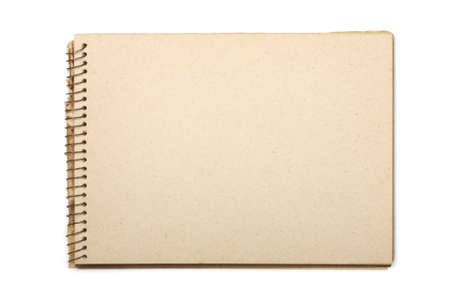 A blank open wide aged notebook with recycled paper. Isolated on white with clipping path. photo