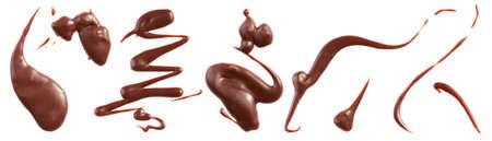 Milk chocolate splashes isolated on white