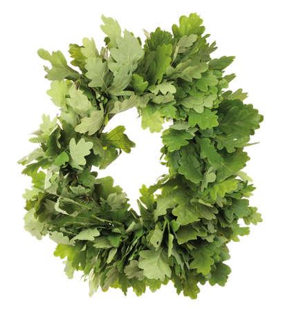 Wreath of oak leaves. Isolated on white. Latvian Midsummer holiday symbol. Stock Photo