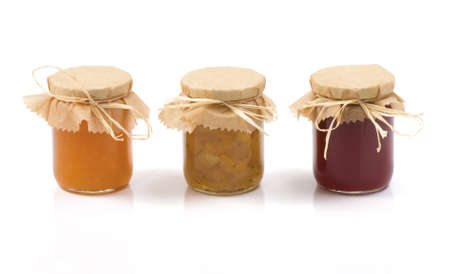 Three jars of jam isolated on a white background. Orange jam. Apples, cabbage and cardamom jam. Currant jam.
