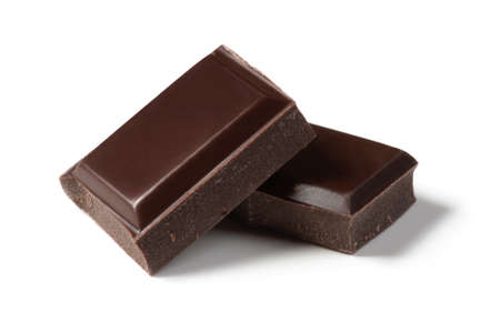Two pieces of chocolate isolated on white background. Cleaned and retouched photo. Stock Photo