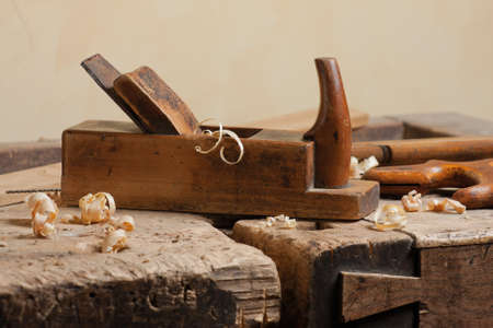 Wood planer and shavings at carpenters workshop photo