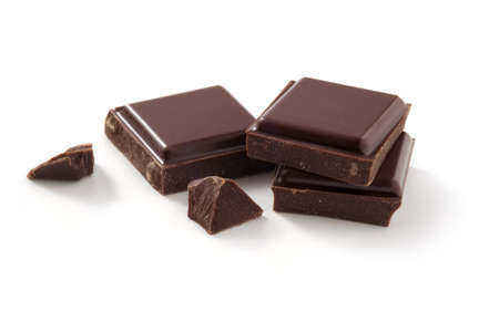 A few pieces of chocolate isolated on white  Cleaned and retouched photo  Clipping path included