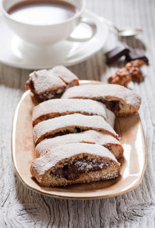 Biscotti with chocolate cream and a cup of coffee  Close up  photo