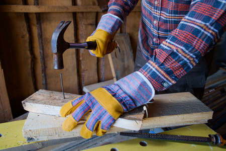 Carpenters hands preparing to pound in a nail photo