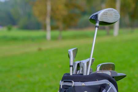 golf equipment over green field background