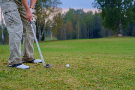 Close up shot of golfer ready to tee off. Meadow golf field. Stock Photo