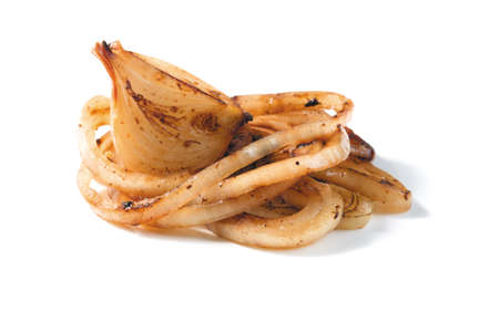 roasted onion pieces on a white background. closeup Stock Photo