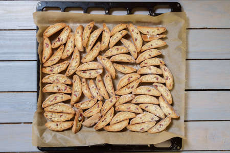 Italian cantucci biscuits cooked on a baking pan