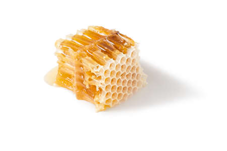 Piece of honeycomb with honey in closeup, healthy products by organic ingredients Stock Photo