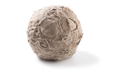 Old, shabby leather soccer ball on white background.