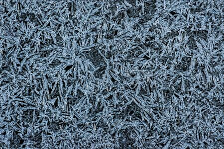 texture blue frosty pattern on black glass seamless 写真素材