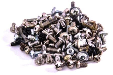 bunch of screws macro closeup on white background isolated