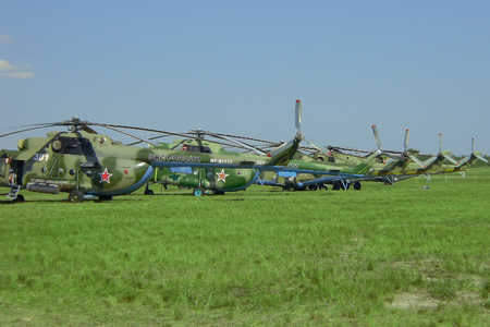 SYZRAN, RUSSIA - SEPTEMBER 13, 2014: many tails of Russian military transport helicopters