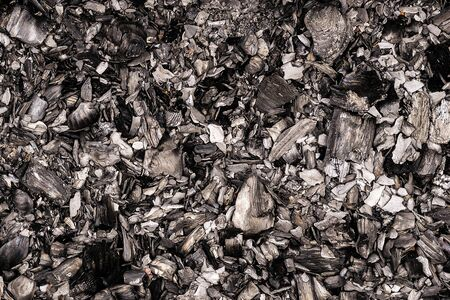 black burnt embers close up background texture