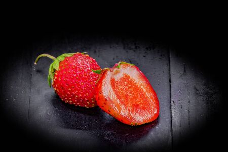 strawberry on a black wooden background