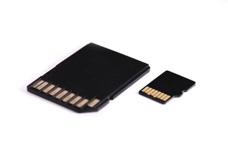 SD and microSD Memory card for digital camera. These two secure digital compact flash memory sticks are isolated on a white background.