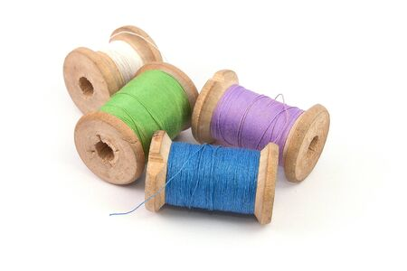 green blue purple white sewing thread on white background isolated Stockfoto